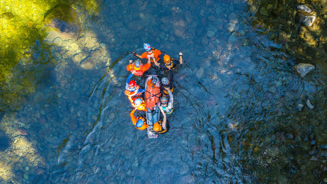 Search and Rescue Training Carrying Patient through a River