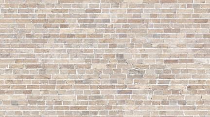 Brick wall seamless texture. Beige stone pattern background