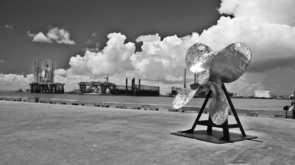 Old Rusty Ship Propeller Against Cloudy Sky