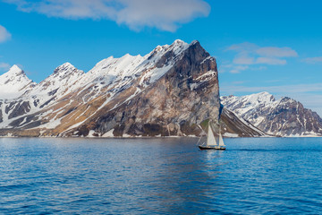 Small sailing vessel with beautiful lighting in Svalbard