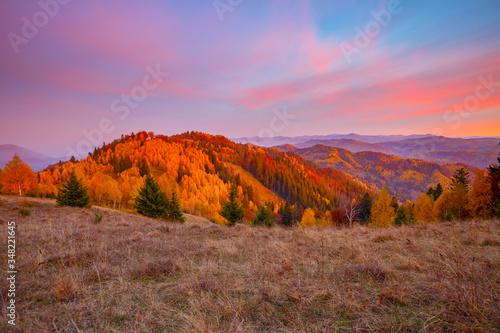 Wall mural Splendid sunset in the autumn alpine highlands. Location place Carpathian mountains, Ukraine, Europe.