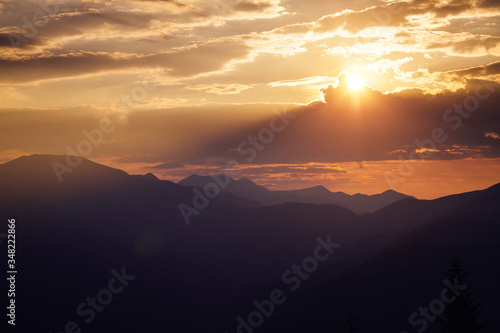 Wall mural Awesome sunset in the alpine highlands. Location place Carpathian mountains, Ukraine, Europe.