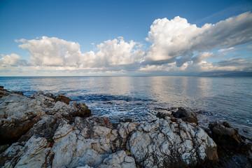 壁紙(ウォールミューラル) - Blue sky with white clouds in the seascape on a sunny day.