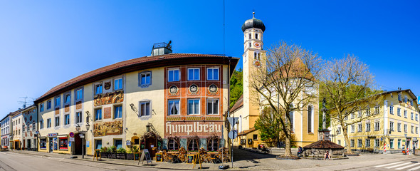 Wolfratshausen, Germany - April 23: famous bavarian old town with church and historic buildings of Wolfratshausen on April 23, 2020