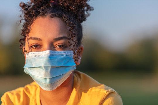 African American Teenager Girl Woman Wearing Coronavirus COVID-19 Face Mask