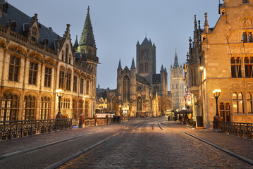 Illuminated street near St Michael bridge and St Bavo's Cathedral in a historical center of Ghent city. Night cityscape. Travel guide, national landmark, sightseeing theme. Belgium Fototapete