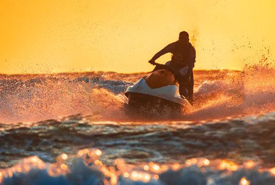 Man jet skiing in tropical water in Goa at baga beach