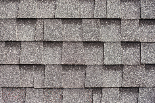Gray shingles for covering the roof. Building material flexible tile background.