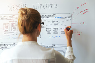 Fototapeta UI UX designer drawing new website wireframe obraz