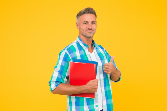 Free courses. Keep learning. College university education. Man adult student. Graduation concept. Dedicated to studying. Student with textbooks. Regular student carry workbooks. Student life