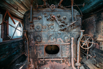 Old steam engine of abandoned steam locomotive Inside driving cabin
