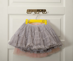 Hangers with beautiful lace skirts on white door