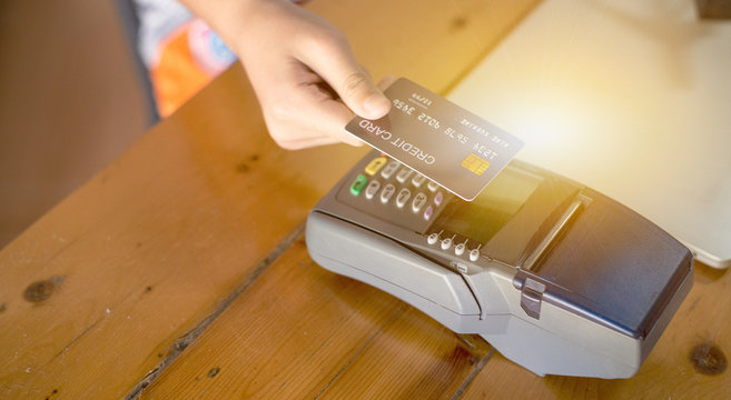 Payment for goods via the automatic credit card system Through wireless magnetic waves called electronic payment systems, Paywave, Contactless payment concept.
