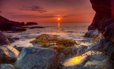 Long Exposure stones during sunset on Palolem beach, Goa Fotobehang