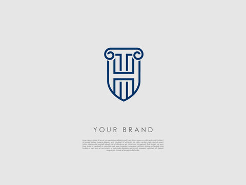 a blue business logo that looks like a shield and has representations of an ancient column, letter h and t