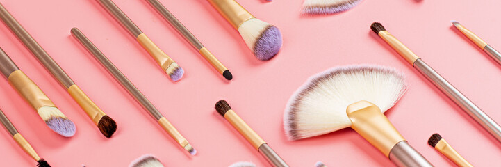 Cosmetic Makeup brushes on pink background. Makeup accessories, mockup, template. Horizontal long banner for web design Fotomurales