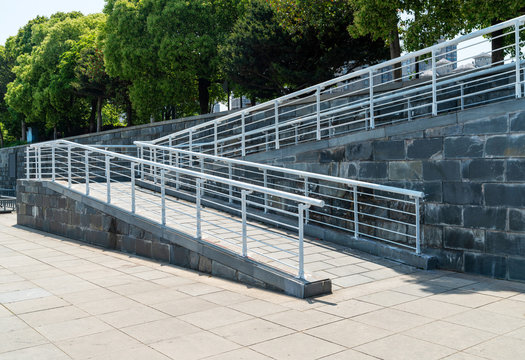 A wheelchair ramp, an inclined plane installed in addition to or instead of stairs