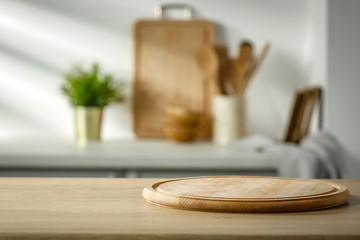 Fototapete - Wooden table in the kitchen with incoming morning sunlight with free space for an advertising product