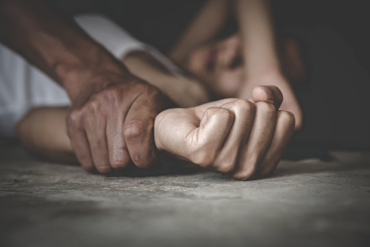 Man's hand holding a woman hand for rape and sexual abuse,  Hands for rape and sexual abuse concept, Sexual abuse is a problem or Social issues concept.