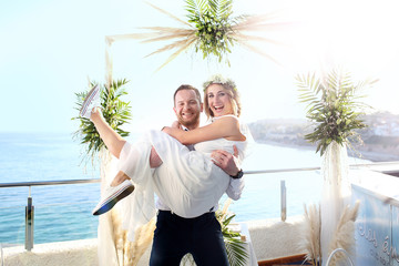 Romantic intimate wedding. A couple during a beach wedding ceremony.
