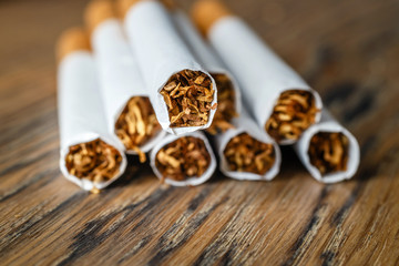 Close up of a hndmade smoking cigarettes on wooden background