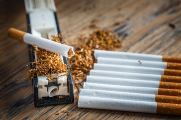 hand-made cigarettes at home using a manual machine