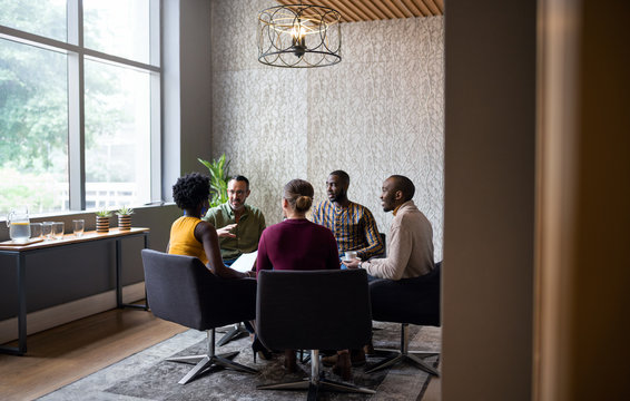 Diverse businesspeople having a casual meeting together in an of