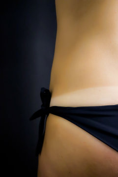 detail of model`s body before and after applying airbrush tan treatment in beauty salon. fake tan on woman`s body