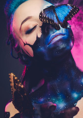 Foto op Textielframe Body Paint Beautiful woman with blue hair and butterfly