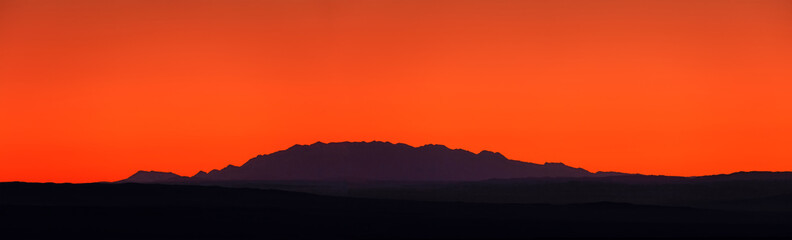Keuken foto achterwand Rood Incredible sunset in the mountains. colors of nature. Sunset panorama on the background of mountains