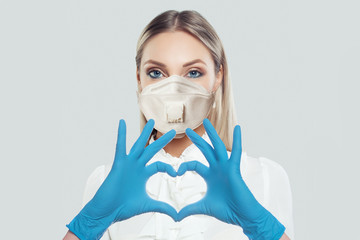Cute woman in protective mask making heart. Healthcare, medicine and treatment concept