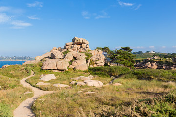 Perros-Guirec, France. Hiking trail among pink granite rocks