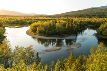 Fotomurales - Sunset at a horseshoe bend in a river in the wilderness of Jamtland, Sweden.