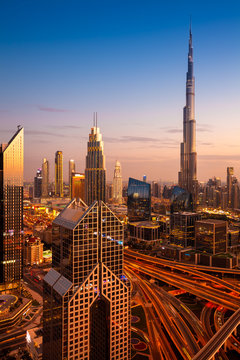 The view of the futuristic Dubai skyline and Sheikh Zaed road at dusk, UAE.
