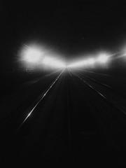 Spoed Fotobehang Spoorlijn Railroad Tracks At Illuminated Tunnel