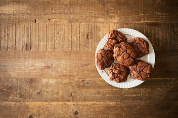 Dark chocolate cookies with macadamia nuts in a rustic environment