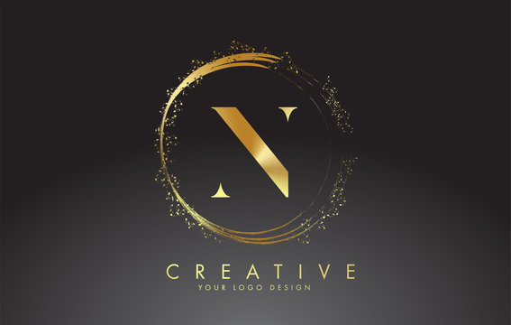 N golden letter logo with golden sparkling rings and dust glitter on a black background. Luxury decorative shiny vector illustration.
