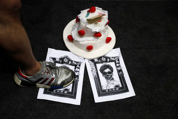 A poster depicting Hong Kong Chief Executive Carrie Lam and a birthday cake are pictured during an anti-government protest to mock her on her birthday at Mong Kok, in Hong Kong