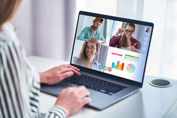 Employee talking with colleagues on video conference. Freelance team using computer for online...