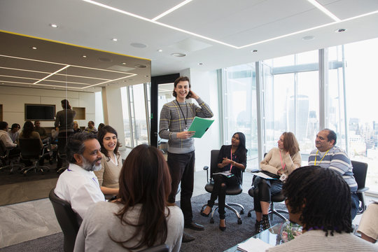 Smiling businessman leading meeting in office