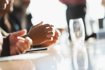 Hands of business people in meeting
