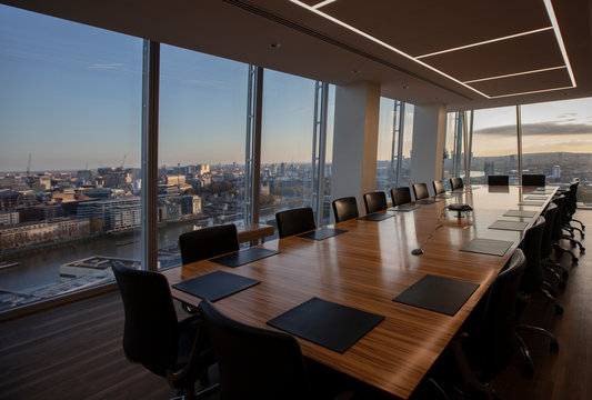 Modern highrise conference room table overlooking city