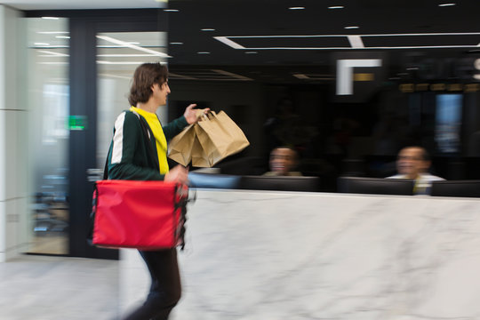 Messenger delivering lunch to business office