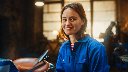 Young Beautiful Empowering Woman Gently Smiles at the Camera. Authentic Fabricator Wearing Work...