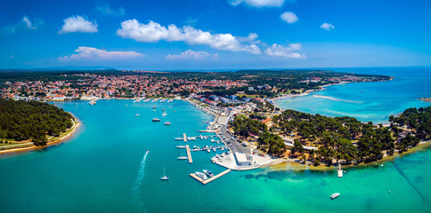 Fototapeta Beautiful wide panoramic aerial view from Medulin town and Medulin marina and boats under beautiful blue sky with nice white clouds aerial view, Croatia
