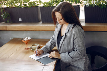 Wall Mural - Woman working with a notebook. Lady with a coffee