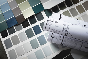 paint samples with kitchen blueprint for remodeling, focus is on paint swatches