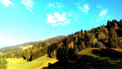 Fototapeten Licht blau Trees On Countryside Landscape Against Mountain Range