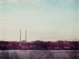 Fototapeta View Of Cityscape By River Against Sky