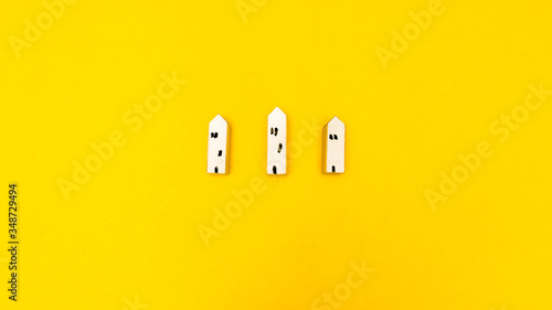Wall mural Home on yellow background top view minimalistic concept